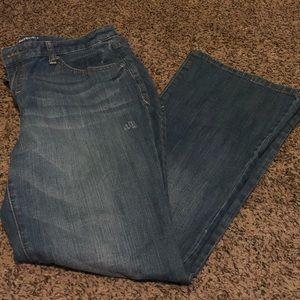 Medium wash, bootcut jeans. SHORT